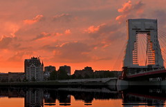 One of those (louise peters) Tags: sunset sundown zonsondergang city stad sky clouds wolkenlucht red orange rood oranje oranjerood willemsbrug bridge maas meuse river rivier wittehuis rotterdam