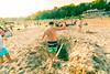 Walk the Plank (VBuckley.com) Tags: bradfordbeach beach sand sun fun milwaukee laborday sky lakemichigan people crowd volleyball swimsuit bikini boardshorts plank balance log ditch hole wideangle canon rokinon 14mm summer beachvolleyball sandvolleyball