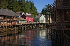 Ketchikan Shops 2 (brev99) Tags: tamron28300xrdiif ketchikan alaska d610 colorful ononesoftware on1photoraw2017 reflections water town buildings shops trees nikviveza