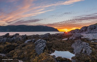 The sun sets over Norris Point