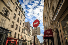 Except (Atomic Eye) Tags: montmartre paris france sign street alley city urban 18tharrondissement ruedesmartyrs lachaiselongue wineshop urbanphotography travel europe rightbank clouds sky windows shutters bokeh dof bicycle