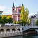 Triple Bridge and the Franciscan Church of Annunciation seen from the Bridge over Ljubljanica River, Ljubljana, Slovenia