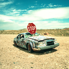 stop in the name of love. goldfield, nv. 2016. (eyetwist) Tags: eyetwistkevinballuff eyetwist goldfield nevada internationalcarforestofthelastchurch carforest graffiti wreck junk abandoned rusty ghosttown film analog analogue xpro mamiya6mf mamiya50mmf4l 50mm kodak ektachrome e100vs lenstagger kodakektachromee100vs crossprocessede6toc41 crossprocess crossprocessed mamiya 6mf ishootfilm emulsion mamiya6 square 6x6 mediumformat 120 ishootkodak 100vs epsonv750pro 6 cross process processed old ghost town mojavedesert desert saturated contrast rust decay junkyard art tag gasoline last church lincoln continental markviii ford stopsign stop sign type typography typographic red lastchurch wheels