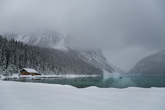 On The Water- contest entry (The 10 cent designer) Tags: lakelouise banffnationalpark kayaking mountains snow blue water winter