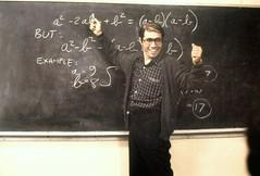 MSDSTAN EC039 (hilaryc.anderson) Tags: 1980smovies 1988movies armsraised blackboard chalkboard eyeglasses formula mathematics movies olmosedwardjames portrait sweater teacher