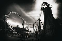 Rollercoaster (Markus_Berger_Pictures) Tags: monochrome monochrom wien prater fairytale linesandcurves curves vienna rollercoaster achterbahn dramatisch fineart amusementpark wienerprater dark clouds themepark