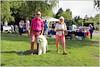 Walking the dog - wearing pink (www.nielsdejgaard.dk) Tags: hund dog lyserød pink tisvilde hundeluftning walkingthedog puddelhund poodle streetphotography