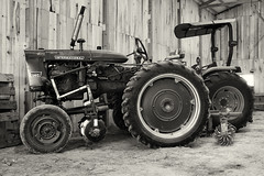 In the tractor barn (citrusjig) Tags: fuji xe1 supertakumar28mmf35 blackandwhite toned tractors barn