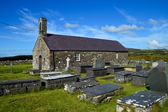 St. Maelrhys Church (rustyruth1959) Tags: nikon nikond3200 tamron16300mm uk alamy wales northwales llynpeninsula rhiw porthysgo church graves headstones stmaelrhyschurch medieval religiousbuilding building bell tower windows stone walls outdoor southernaspect sky belltower rubblestone cross clouds churchyard