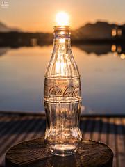 A Bottle of Midnight Sun (Tobias Neubert Photography) Tags: norwegen norway norge lofoten flasche bottle cocacola sonne sun mitternachtssonne midnightsun wasser water meer sea berg berge mountain mountains reise travel