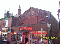 Chorley08 (Landstrider1691) Tags: baptistchapel chapel chorley 1848 1800s 19thcentury musicland grandmaskitchen churchtower music tapes discs cafe shop shopwindow chimneys chimneypots