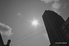 The sky of Naples (Corrado Volpicelli) Tags: napoli naples napòles sky black sun sole skyline grattacielo city città metropoli hotel cielo lights