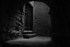 A Ligurian village 2 (PascallacsaP) Tags: velva liguria genova italy italia genoa street underground shadow light dark door stairs arch vault bw blackandwhite acros fujifilm film simulation walls broom steps old village ancient daylight hidden medieval