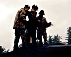 Deborah Eadie is helped into the turret of a Swiss Army tank (photo by Roger Johnson)