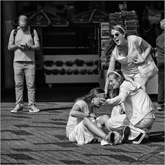 Oops (John Riper (OFF for awhile)) Tags: johnriper street photography straatfotografie square vierkant bw black white zwartwit mono monochrome netherlands candid john riper canon rotterdam marine port worldportdays wereldhavendagen 6d 70200 l girls man phone fun