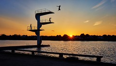 3-2-1 Action, Norway (Vest der ute) Tags: xt2 norway rogaland haugesund water waterscape landscape divingtower people sunset sunstar sky clouds outdoor silhouettes lake fav25