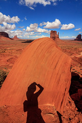 Shadow selfie at Monument Valley (Rod Heywood) Tags: monument valley navajo utah arizona american west iconic mesas buttes forest westerns cowboy red desert scenic clouds cumulous blue skies landscape western goulding westernlandscape us163 monumentvalley navajonation americanwest forestgump johnwayne cowboycountry sandstone cumulousclouds blueskies shadow selfie rockformations creosotebushscrub scrubbrush