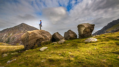 Rock solid.. (Einir Wyn Leigh) Tags: landscape sunny valley mountains exposure rocks stones man outside colorful wales cymru snowdonia blue sky green people person light contrast nikon shadows