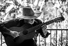 0246937237-92- Pickin Old Cowboy Songs in Balboa Park San Diego-4-Black and White (Jim There's things half in shadow and in light) Tags: 2017 balboapark california canon5dmarkiv sandiego sigma24105mmf4dg vacation mission blackandwhite guitar music musician countrymusic people man