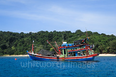 Traditional Fishing Boat (whitworth images) Tags: painted wooden industry paradise blue colorful fishing southeastasia redangisland terengganu redang green coast tropical vessel resort asia nature water malay sea malaysia pulauredang beach fishingboat tourism coastal island outdoors boat colourful red traditional