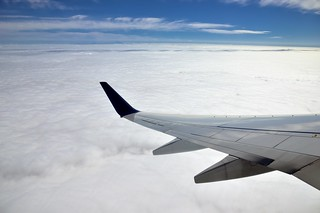 Flying Above the Clouds and Teeny Tiny Mountains off in the Distance