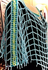 Aquarienne bateau side (vashtirama) Tags: lacing laced convertible poncho wrap shawl p2p pointtopoint crochetpattern crochetbeachcoverup beads dvpublished lotus summer tunisian hires filet colorwork filter seamfinishing cornerstart tunisiancrochetlace triangle shaped vest lacytunisiancrochet tallstitch beach mermaidy coverup drape mesh net tunisiancrochet filetcrochet lace lacy designingvashtilotusyarn lacingcrochet patterndownloadablepdfmydesign vashtiyarn dorischanyarn beaded seedbeads fringe twistedfringe beadedfringe triangular sidetoside s2s vneck bateau crochetlinenstitch crochetmossstitch crochetseedstitch crochetponcho beachponcho