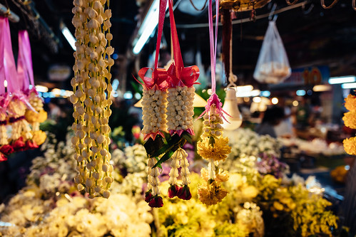 Offering flowers at the market, Chiang Mai