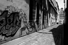 Gerade Querstraße (Von Noorden) Tags: lübeck gasse lane street hau häuser house houses windows black white small cute strase germany fenster fassade shade schatten shadows dark gerade querstrase hansestadt pflaster copple stone paving copplestone grafiti grafitti art streetart flagstone kopfstein grafitto spray sprayer paint painter artist artists youth youthclub youthgang gang blockparty block urban cultur kultur gheddo ghetto hood viertel stadtteil stadt city town kleinstadt hauptstadt capital streetphotography streetphoto famous hamburg munich münchen bremen kiel berlin london paris noiretblanc