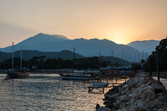 Rays of gold (Anthony P26) Tags: boat category flickrpost kemer kemerbay places seascape transport travel turkey antalya mtolympos taurusmountains harbour bay moonlightbay rocks jetty pier hills mountains sky goldenrays goldencolours goldenlight waves ripples sea reflectedlight canon1585mm canon70d canon travelphotography landscapephotography outdoor