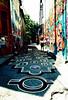 Numbered Alley (Georgie_grrl) Tags: pedestriansunday july2017 kensingtonmarket musicians performers buskers community pentaxk1000 rikenon12828mm toronto ontario expiredfilm graffiti mural laneway alley hopscotch game numbers