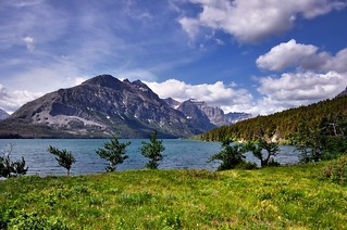 Mountains, a Lake, and Clouds Above (Glacier National Park)