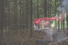 IMG_9489 (J. Adams.) Tags: smoke smokegrenade woods forest tree trees dark shadows red orange nature outside outdoors sparks fire sticks hood hoody portrait aesthetic fade faded canon dslr eos 650d
