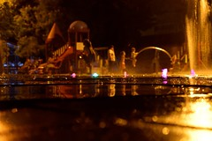 Crazy night view (fdlscrmn) Tags: children people park night fountain nightlights drops reflection water bokeh colours colorful kids downtown candid life