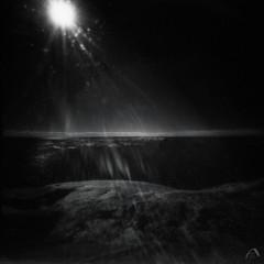 Nightly sunshine (ShimmeringGrains) Tags: ir720 sunbeams mediumformat infrarödfilm impressionistic bw svartvitt filmphotography pinhole ©marieahlén irwater scanned efke820ir scannad shimmeringgrains sensation zeroimage2000btn infraredfilm square irsky impressionisticlandscape irphoto mellanformat 120film 6x6 sunrays pinholephotography sunlightdirectlyintothelens film ir impressionisticseascape infrared zeroimage analog blackandwhite monochrome darksunshine blacksky darksea