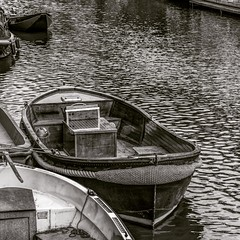 Boat sitting in a canal in Amsterdam (Clicks by Mike) Tags: fx travel amsterdam netherlands d610 nikon blackandwhite canal water boat