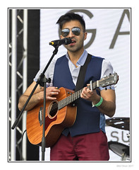 Amar Chotai (Seven_Wishes) Tags: newcastleupontyne newcastleexhibitionpark newcastlemela2017 mela2017 photoborder people portrait candids candidportraits multicultural culture cultural festival music musicfestival culturalfestival pakistani bengali indian southasiancultures canonef100400mmf4556lisii canoneos5dmark4 entertainment liveevent livemusic streetportraits vocalist singer asiansinger asianman ravenhaired silverefex bollywoodsinger bollywood concert musician stage sunglasses waistcoat guitar acousticguitar amarchotai northerndestiny