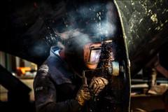 Soudure vitale! / Vital welding! (vedebe) Tags: couleurs travail marine bateaux bateau fumée chantier chantiernaval bretagne rue port ports urbain city ville mer pêche people humain océan