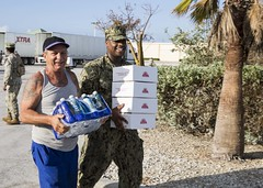 Yeoman 2nd Class Eric Coleman helps a Key West resident. (Official U.S. Navy Imagery) Tags: usnavy navy commander navalairforceatlantic hurricaneirma relief navyair keywest fla unitedstates usa