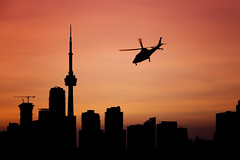 Rotors in the Setting Sun (Jack Landau) Tags: toronto skyline silhouette buildings city urban helicopter aircraft aviation sunset pink orange sky colours cn tower financial district south core ontario canada jack landau