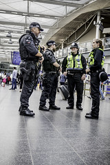 U.K. terror threat level is severe (tootdood) Tags: canon6dmkii fromthehip manchester uk terror threat level severe piccadilly rail station armed police high viz jacket yellow