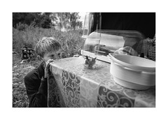 Frogs in the field kitchen (Jan Dobrovsky) Tags: story leicaq boy monochrome people frogs blackandwhite outdoor krumlov document