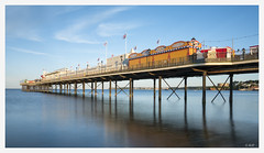 Paignton Pier (robert.french57 French Images) Tags: e26 l1040761 paignton pier devon uk amusements fun free admission family sea coast seaside day sky blue long shutter speed wind flags