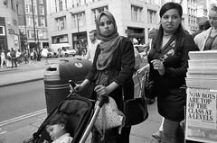 top of the class (Paul Steptoe Riley) Tags: uk england great britain london blackandwhite street oxford women child pram asian headscarf standard headline newspaper newsstand photography