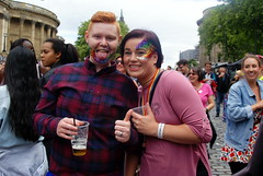 Enjoying the day (* RICHARD M (7.5 MILLION VIEWS)) Tags: street portraits portraiture streetportraits streetportraiture smiles fun couples togetherness drinking happy happiness glitter facepainting pullingtongues tonguepulling plasticglasses redhead redheaded ginger thumbsup quiff liverpoolpride gaypride lgbt liverpudlians scousers merseysiders liverpool merseyside europeancapitalofculture capitalofculture july summer summertime