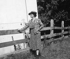 Lady leaning on the fence (vintage ladies) Tags: vintage blackandwhite female woman lady portrait people photograph photo eoshe 40s 40slady 40sstyle 40swoman fence jacket stylish dress hat