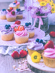 Cupcakes (ChicqueeCat) Tags: cupcakes food buttercream pink purple yellow strawberry fruits nikon d3300 40mm macro closeup