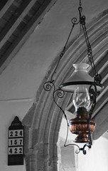 Lamp in Chillington Church-3 (Odd Wellies) Tags: chillington st3811 black hymnboard oillamp whiteandcolour lowerchillington england unitedkingdom
