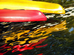 Two Canoes (duaneschermerhorn) Tags: canoe canoes reflection red yellow abstract abstractreflection water green lake