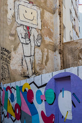 Valencia Side Street (2) (Olympus OM-D EM1-II & Panasonic Lumix G 20mm f1.7 Pancake Prime) (1 of 1) (markdbaynham) Tags: valencia spain es espana espanol vlv city urban metropolis oly olympus omd em1 em1ii em1mk2 csc mirrorless evil mft m43 m43rd micro43 micro43rd panasonic lumix lumixer g 20mm f17 pancake prime street graffiti art sidestreet wall vlc valenciacanibal