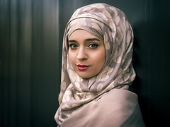 Naziyah [Revisited] (Leanne Boulton) Tags: people urban street pose posed portrait portraiture streetphotography streetportrait eyecontact streetlife 100strangers woman female girl pretty face facial expression look emotion feeling mood atmosphere muslim hijab beauty beautiful eyes makeup style stylish fashion orange teal cinematic splittone processing frequencyseparation scientist astrophysics tone texture detail depthoffield bokeh naturallight outdoor light shade shadow city scene human life living humanity society culture canon canon7d character color colour glasgow scotland uk